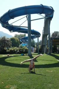Cartwheels under the waterslide.