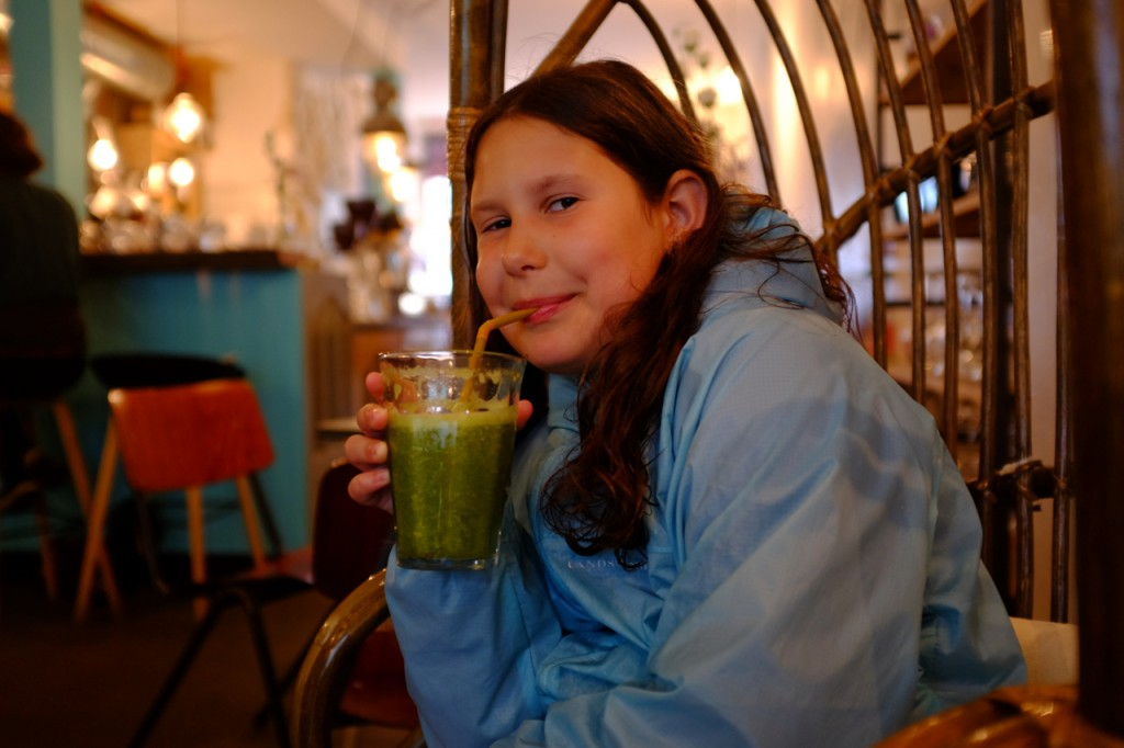 Enjoying a green smoothie.