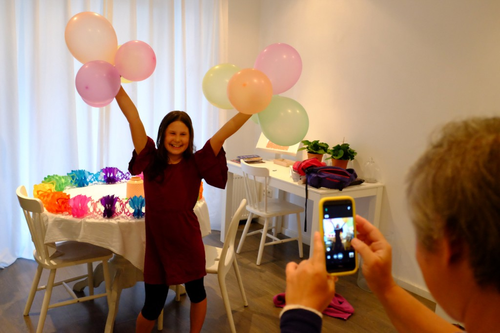 Posing for photos with 10 balloons.