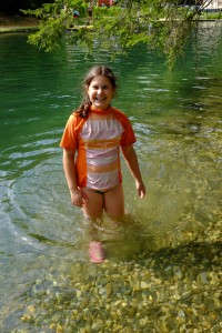 The clear water of the swimming hole.