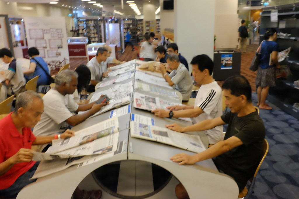 Old guys reading newspapers