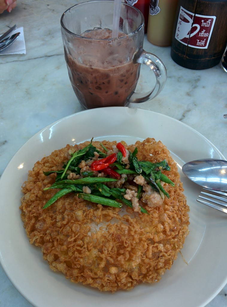 Crispy egg with pad krapow moo and iced coco.