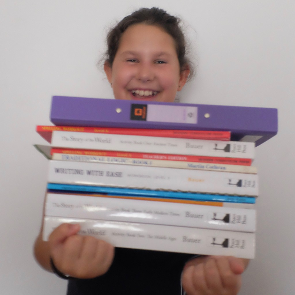 Jette with her notebook and some of her books