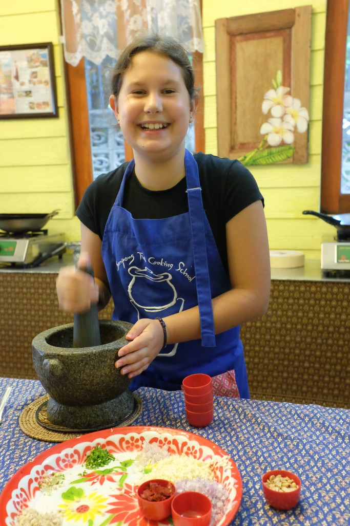 Working the mortar and pestle.