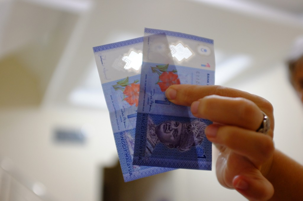 Malaysian Ringgit is made of plastic. Note the clear windows at the top of the bills.