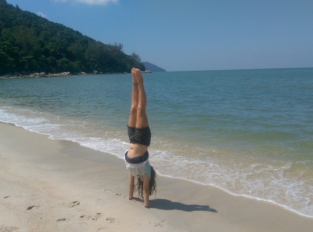 Handstand on the beach across from Tropical Spice Garden