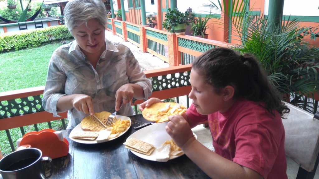 Breakfast is scrambled eggs and arepas, with coffee or hot chocolate.