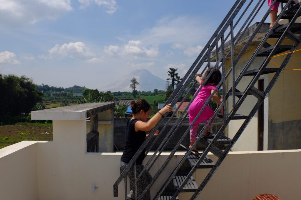 Climbing to the roof to look at Sinabung