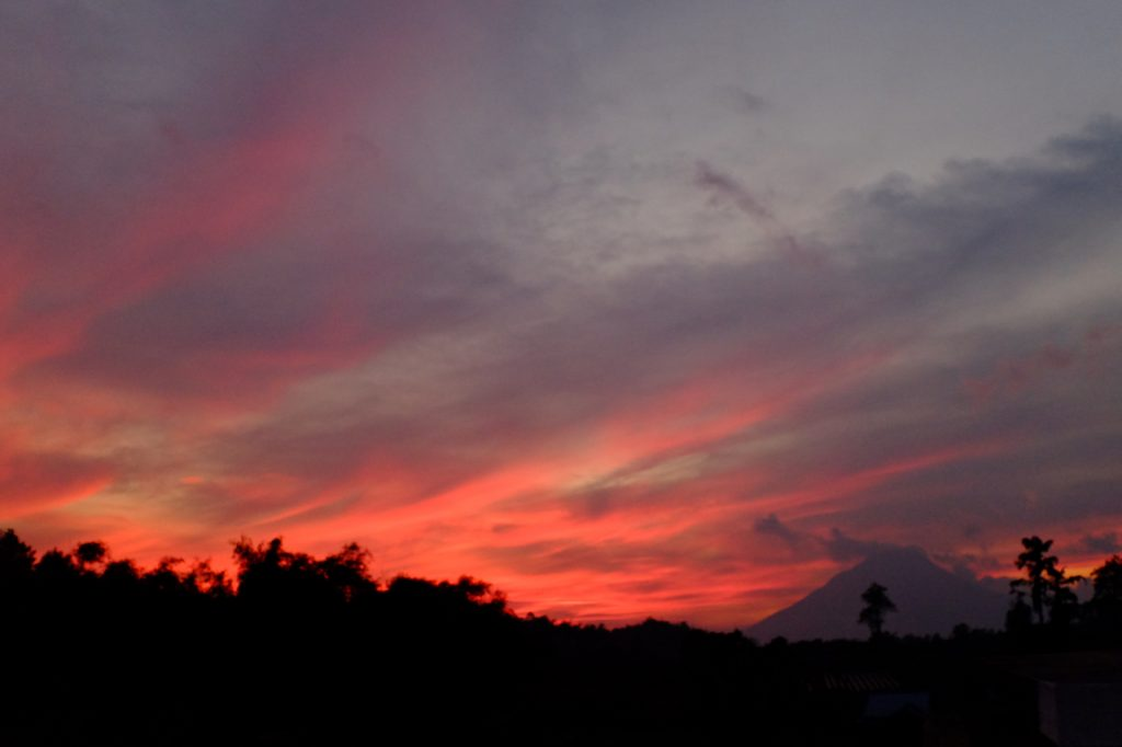 Sinabung smoulders at sunset