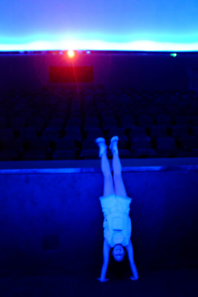 When you are the first one in the theater you can do handstands!